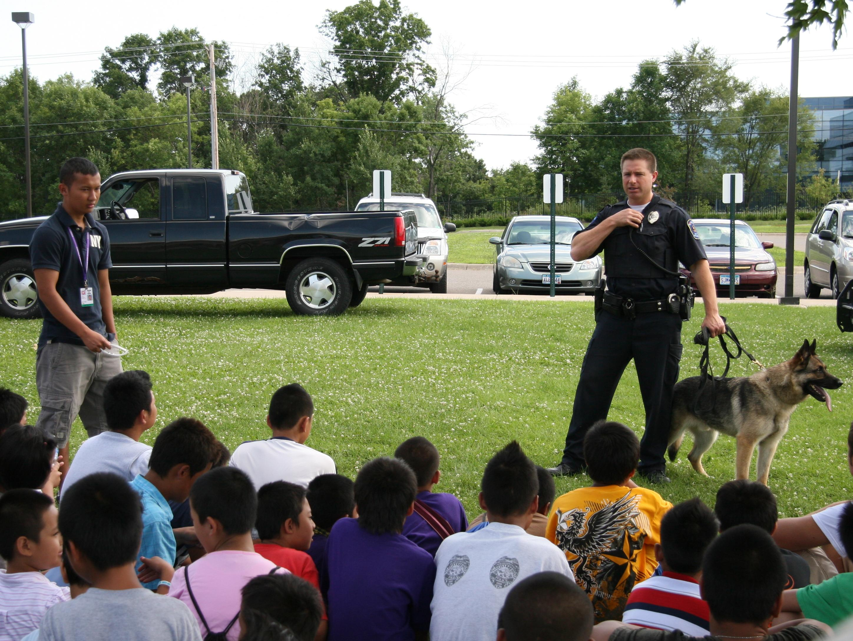 Officer Gray and Tasco providing a K9 demo during a summer program